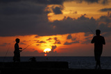 People Fish at Havana's Seafront Boulevard -El Malecon- During Sunset Photographic Print by Desmond Boylan