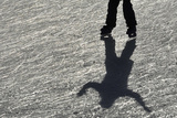 A Visitor Skates on the Ice Rink at Tower of London Photographic Print by Toby Melville