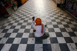 A Beggar Waits for Alms Outside a Hindu Temple in New Delhi Photographic Print by Adnan Abidi1
