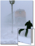 A Man Crosses a Railway Track During Heavy Snowfall Poster by Eduard Korniyenko