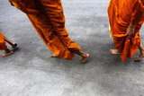 Buddhist Monks Walk in Downtown Bangkok Photographic Print by Yannis Behrakis