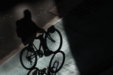 An Worker Pedals on a Bike Line in Central Sydney Photographic Print by Daniel Munoz