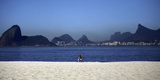 A Man Sunbathes at the Praia De Icarai Beach in Niteroi Photographic Print by Ricardo Moraes