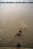 A Man Fishes in the Sindh River in Sukkur in Pakistan Photographic Print by Akhtar Soomro
