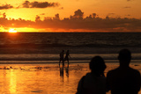 Tourists Watch the Sunset from Kuta Beach in Indonesia's Resort Island of Bali Photographic Print by Stringer Indonesia