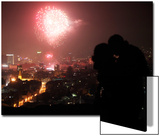 A Couple Kiss as Fireworks Light the Sky During New Year Celebrations in Sarajevo Posters by Dado Ruvic