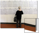 A Woman Checks a List of Places to Vote in Sao Paulo Print by STRINGER Brazil