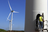 An Employee Works at the Los Cocos Wind Farm in Juancho Pedernales Photographic Print by  Stringer
