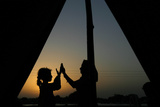 Girls, Who are Victims of the Floods Play Outside their Tent During Dusk Photographic Print by Athar Hussain