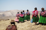 Female Shepherds Walk Near the Andean District of Larakeri at the Highlands of Puno Photographic Print by Enrique Castro-Mendivil