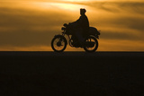An Afghan Man Rides a Motorcycle as the Sun Sets at Delaram District in Nimroz Province Photographic Print by Marko Djurica