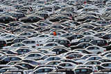 A Worker Walks Along Rolls of Mercedes Cars Photographic Print by Fabian Bimmer