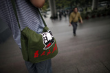 A Man Carries a Bag with a Picture of Former Chinese Leader Mao Zedong Photographic Print by Carlos Barria