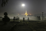 A Woman Exercises in a Public Park Near Shwedagon Pagoda in Yangon Photographic Print by Soe Zeya Tun