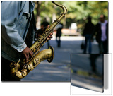 A Man Plays the Saxophone in New York's Central Park Posters by Shannon Stapleton