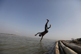 A Boy Dives into the Water to Take a Shower Along the Bank of the Irrawaddy River Photographic Print by Soe Zeya Tun