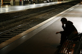 A Commuter Waits for His Train at the Lille-Flandres Station in Northern France Photographic Print by Pascal Rossignol