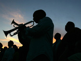 New Orleans Residents Play Trumpet During a Candlelight Ceremony Photographic Print by Carlos Barria