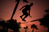 A Man Performs on the Slackline at a Park in Lima Fotografie-Druck von Pilar Olivares