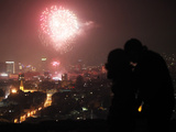 A Couple Kiss as Fireworks Light the Sky During New Year Celebrations in Sarajevo Photographic Print by Dado Ruvic