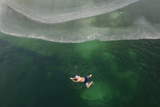 A Winter Swimmer Swims in a Partially Ice-Covered Pond in Changzhi, Shanxi Province Photographic Print by Stringer Shanghai