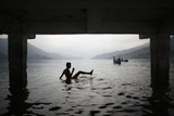 A Boy Swims in Phewa Lake in Pokhara Valley Photographic Print by Navesh Chitrakar