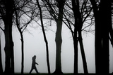 A Woman Walks Through Thick Fog in Leicester Photographic Print by Darren Staples