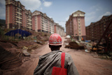 A Labourer Walks at a Construction Site in Badong, on the Banks of the Yangtze River Photographic Print by Carlos Barria