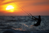 A Man Kite Surfs in the Mediterranean Sea in Ashkelon Photographic Print by Amir Cohen