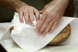 Baker Wraps a Loaf of Bread in Paper in His North Sydney Bakery Photographic Print by TIM WIMBORNE