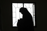 A Muslim Woman Is Silhouetted Photographic Print by Cheryl Ravelo