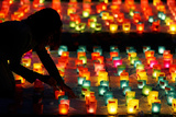 A Volunteer Sets Up Candles During Swiss National Day in Berne Photographic Print by Pascal Lauener