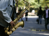 A Man Plays the Saxophone in New York's Central Park Photographic Print by Shannon Stapleton