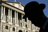 Actor in Bowler Hat Silhouetted in Front of the Bank of England During Television Programme Filming Photographic Print by Luke MacGregor