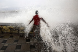 A Boy Is Hit by a Large Wave During High Tide at Mumbai's Seafront Photographic Print by Danish Siddiqui