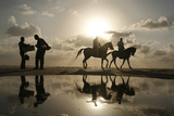 Palestinian Men Ride Horses During Sunset on the Beach of Gaza City Photographic Print by Mohammed Salem