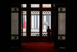 A Woman Looks Out at Tiananmen Square from Inside the Great Hall of the People in Beijing Photographic Print by David Gray