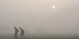 Students Walk Towards their School Amid Heavy Fog on the Outskirts of Chandigarh Photographic Print by Ajay Verma