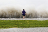 New Orleans Resident Diana Whipple Stands on the Shore of Lake Pontchartrain Photographic Print by Jonathan Bachman