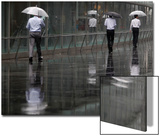 Businessmen are Reflected on a Wet Pavement as They Walk in the Rain in Tokyo Posters by Yuriko Nakao