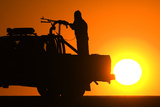 Afghan National Policemen (Anp) Travel in their Vehicle as the Sun Sets Photographic Print by Marko Djurica