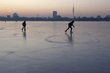 Couple Skates on the Frozen Inner City Lake Alster in Hamburg Photographic Print by Christian Charisius