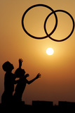 Children Play with Tyres During Sunset on the Outskirts of the Northern Indian City of Chandigarh Photographic Print by Kamal Kishore