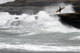 A Lone Surfer Waits to Enter the Water as the Coastline Is Hit by Large Surf During a Winter Storm Photographic Print by Mike Blake