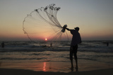 A Palestinian Fisherman Throws His Net During Sunset in Gaza City Photographic Print by Mohammed Salem