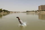 A Resident Jumps into the Tigris River for a Swim on a Warm Summer Day in Baghdad Photographic Print by Saad Shalash