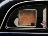 A Passenger Being Driven in a Taxi Passes a Bricked-Up Atm Machine Slot in the City of London Photographic Print by Toby Melville
