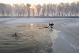 People Swim in Icy Water at a Park in Shenyang Photographic Print by Stringer Shanghai