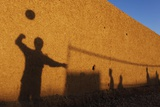 Shadows are Cast on a Wall by Afghan Soldiers Playing Volleyball Fotografisk trykk av Finbarr O'Reilly