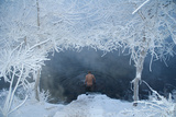 A Swimmer Walks in the Songhua River During Winter in Jilin Photographic Print by China Daily